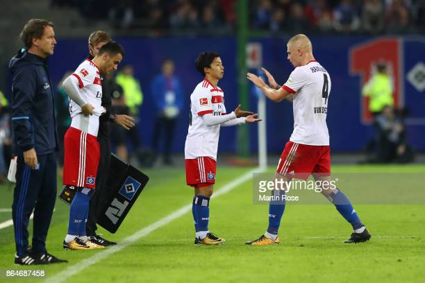 Tatsuya Ito of Hamburg comes on as a substitute for Rick van Drongelen of Hamburg during the Bundesliga match between Hamburger SV and FC Bayern...