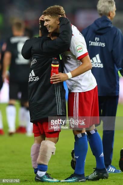 Tatsuya Ito of Hamburg embraces JannFiete Arp of Hamburg after the Bundesliga match between Hamburger SV and VfB Stuttgart at Volksparkstadion on...