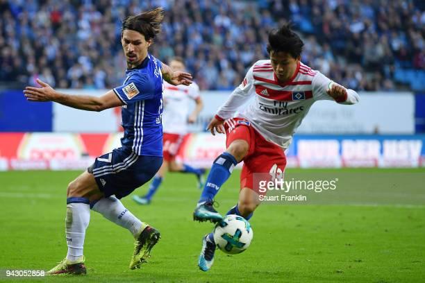 Tatsuya Ito of Hamburg fights for the ball with Benjamin Stambouli of Schalke during the Bundesliga match between Hamburger SV and FC Schalke 04 at...