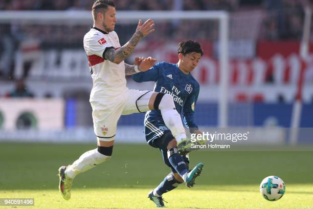 Tatsuya Ito of Hamburg fights for the ball with Daniel Ginczek of Stuttgart during the Bundesliga match between VfB Stuttgart and Hamburger SV at...