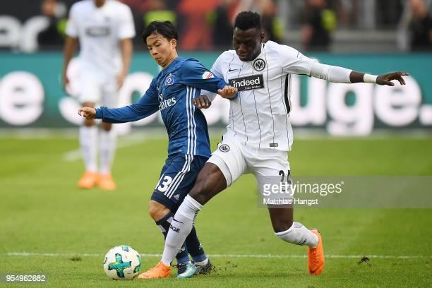Tatsuya Ito of Hamburg fights for the ball with Danny da Costa of Frankfurt during the Bundesliga match between Eintracht Frankfurt and Hamburger SV...
