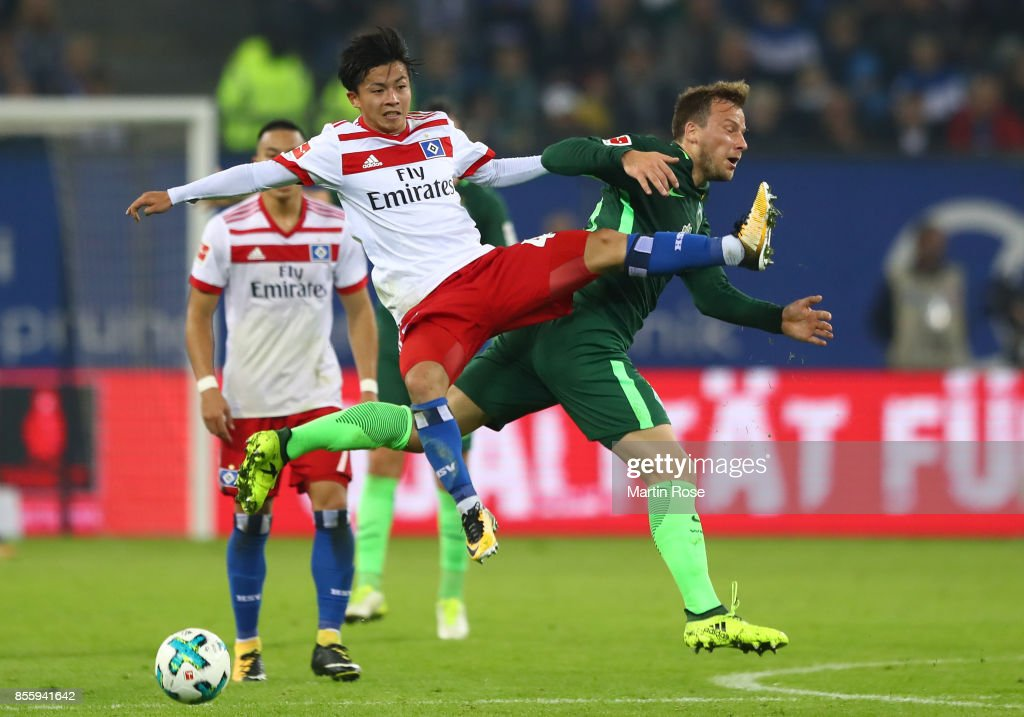 Tatsuya Ito of Hamburg (l) fights for the ball with Philipp Bargfrede of Bremen during the Bundesliga match between Hamburger SV and SV Werder Bremen at Volksparkstadion on September 30, 2017 in Hamburg, Germany.