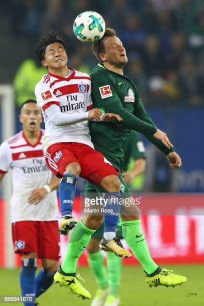 Tatsuya Ito of Hamburg fights for the ball with Philipp Bargfrede of Bremen during the Bundesliga match between Hamburger SV and SV Werder Bremen at...
