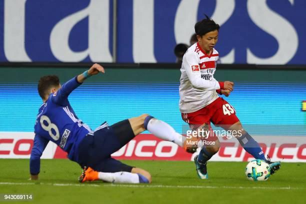 Tatsuya Ito of Hamburg goes past Leon Goretzka of Schalke during the Bundesliga match between Hamburger SV and FC Schalke 04 at Volksparkstadion on...