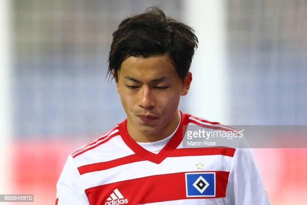 Tatsuya Ito of Hamburg has to leave the match injured during the Bundesliga match between Hamburger SV and SV Werder Bremen at Volksparkstadion on...