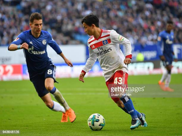 Tatsuya Ito of Hamburg is challenged by Leon Goretzka of Schalke during the Bundesliga match between Hamburger SV and FC Schalke 04 at...
