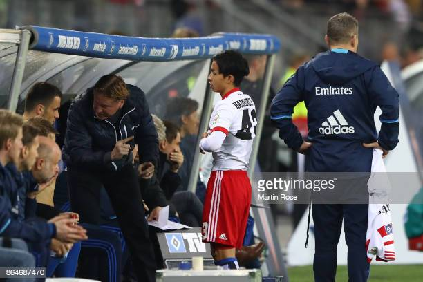 Tatsuya Ito of Hamburg is ready to come on as a substitute during the Bundesliga match between Hamburger SV and FC Bayern Muenchen at...