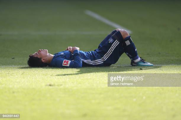 Tatsuya Ito of Hamburg lies on the pitch dejected after the Bundesliga match between VfB Stuttgart and Hamburger SV at MercedesBenz Arena on March 31...