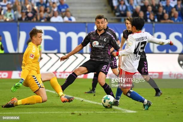 Tatsuya Ito of Hamburg plays the ball during the Bundesliga match between Hamburger SV and SportClub Freiburg at Volksparkstadion on April 21 2018 in...