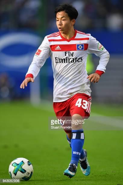 Tatsuya Ito of Hamburg runs with ball during the Bundesliga match between Hamburger SV and FC Schalke 04 at Volksparkstadion on April 7 2018 in...