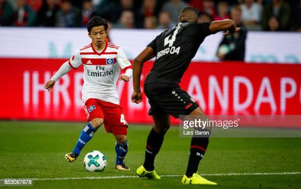 Tatsuya Ito of Hamburg runs with the ball the Bundesliga match between Bayer 04 Leverkusen and Hamburger SV at BayArena on September 24 2017 in...