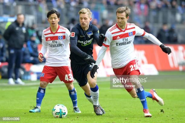Tatsuya Ito of Hamburger SV Arne Maier of Hertha BSC and Matti Steinmann of Hamburger SV during the Bundesliga game between Hamburger SV and Hertha...