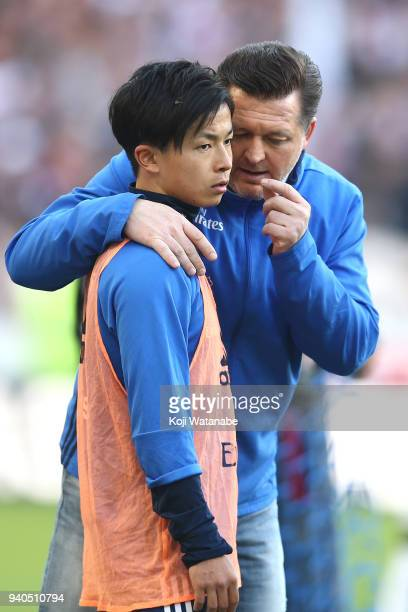 Tatsuya Ito of Hamburger SV is given instruction during the Bundesliga match between VfB Stuttgart and Hamburger SV at MercedesBenz Arena on March 31...