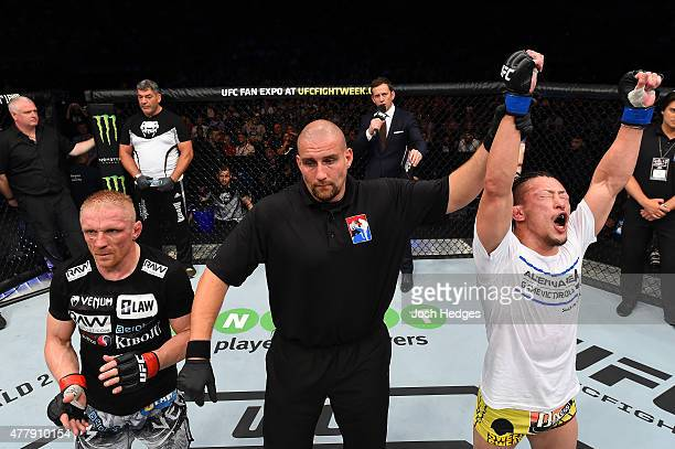 Tatsuya Kawajiri of Japan celebrates after defeating Dennis Siver in their featherweight bout during the UFC Fight Night event at the O2 World on...