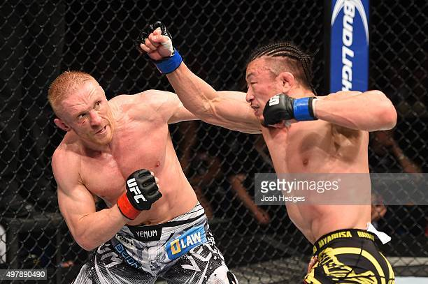 Tatsuya Kawajiri punches Dennis Siver in their featherweight bout during the UFC Fight Night event at the O2 World on June 20 2015 in Berlin Germany