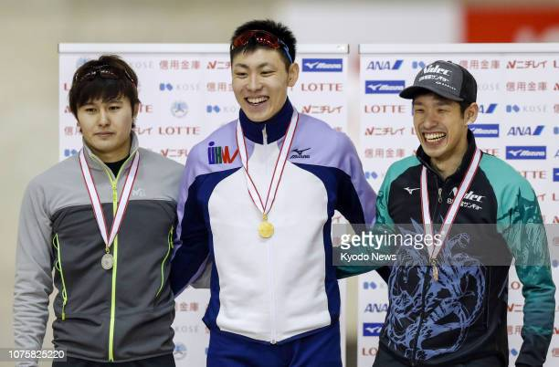 Tatsuya Shinhama poses for photos after winning a men's 500meter event at the national sprint speed skating championships in Obihiro Hokkaido on Dec...