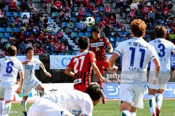 Tatsuya Tanaka of Roasso Kumamoto heads to score his side's first goal during the J.League J2 match between Roasso Kumamoto and Tokushima Vortis at...