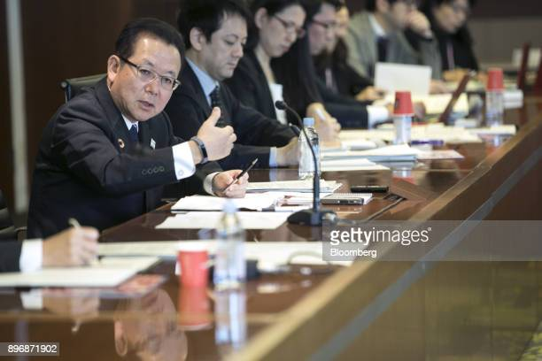 Tatsuya Tanaka president of Fujitsu Ltd left speaks during a roundtable interview in Tokyo Japan on Friday Dec 22 2017 Fujitsu and Microsoft Corp...