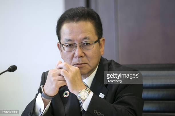 Tatsuya Tanaka president of Fujitsu Ltd listens during a roundtable interview in Tokyo Japan on Friday Dec 22 2017 Fujitsu and Microsoft Corp today...