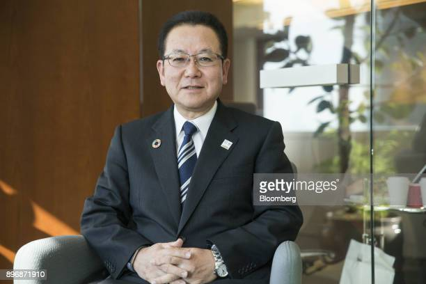Tatsuya Tanaka president of Fujitsu Ltd poses for a photograph in Tokyo Japan on Friday Dec 22 2017 Fujitsu and Microsoft Corp today announced that...