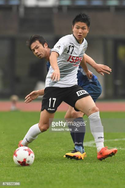 Tatsuya Uchida of Tokyo Verdy controls the ball under pressure of Koji Yamase of Avispa Fukuoka during the JLeague J1 Promotion PlayOff semi final...