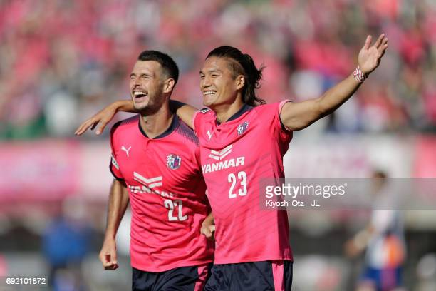 Tatsuya Yamashita of Cerezo Osaka celebrates scoring his side's second goal with his team mate Matej Jonjic during the J.League J1 match between...