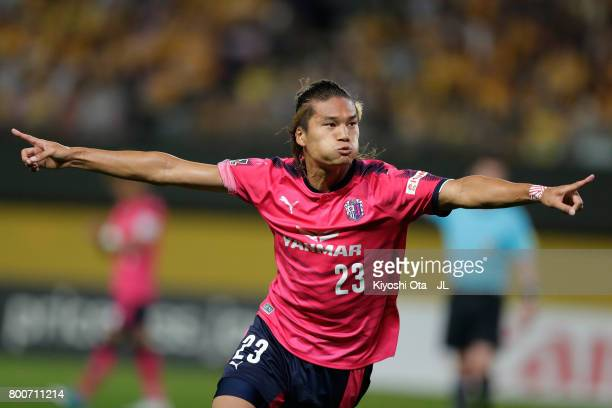 Tatsuya Yamashita of Cerezo Osaka celebrates scoring his side's third goal during the J.League J1 match between Vegalta Sendai and Cerezo Osaka at...