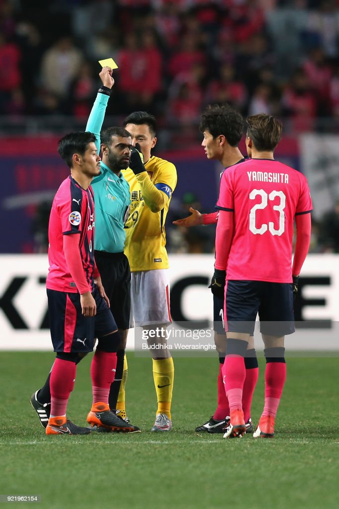Tatsuya Yamashita (1st R) of Cerezo Osaka is shown an yellow card during the AFC Champions League Group G match between Cerezo Osaka and Gunazhou Evergrande at the Yanmar Stadium Nagai on February 21, 2018 in Osaka, Japan.