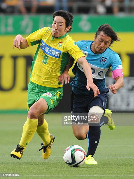 Tatsuya Yazawa of JEF United Chiba and Shinichi Terada of Yokohama FC compete for the ball during the JLeague second division match between JEF...