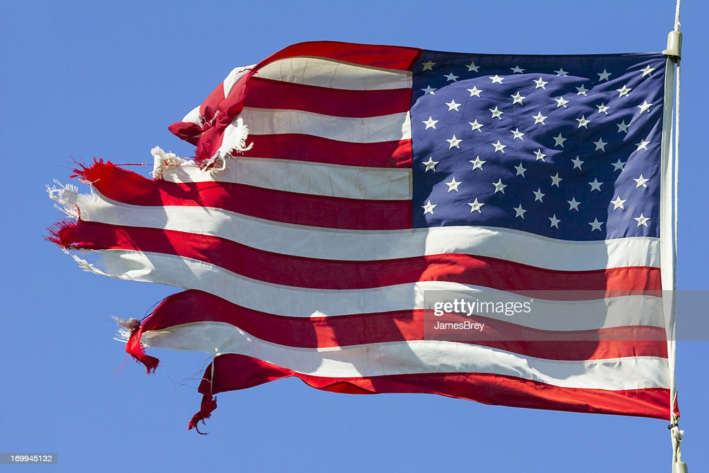 Tattered American Flag, Still Flying Free and Proud : Stock Photo
