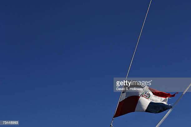 Tattered Dominican Republic flag flies over a catamaran October 25, 2006 off the coast of Mona Island, Puerto Rico.