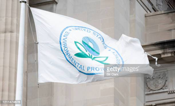 Tattered Environmental Protection Agency flag flies in front of the EPA in Washington on May 1, 2020.