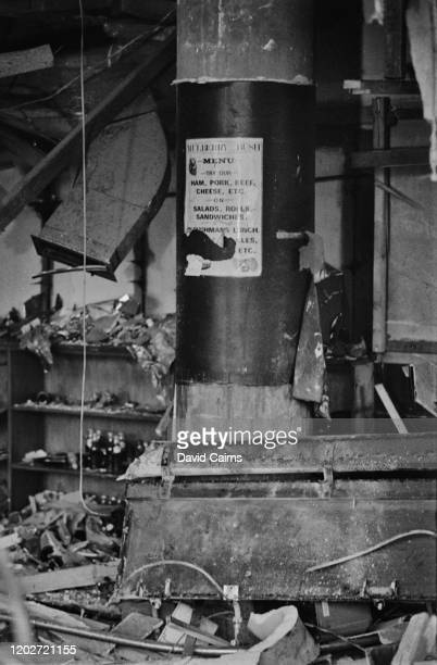 A tattered menu on a pillar in the Mulberry Bush location of one of the two pub bombings on 21st November 1974 in Birmingham West Midlands England...