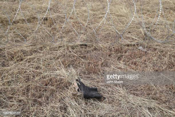 S A tattered shoe lies next to newlystrung razor wire near the USMexico border on November 4 2018 in Donna Texas President Trump ordered the troops...