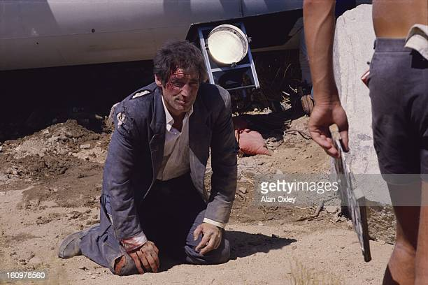 Tattered torn and bloodied with movie makeup James Bond 007 played by Timothy Dalton prepares for a fight scene during the filming of 'Licence to...