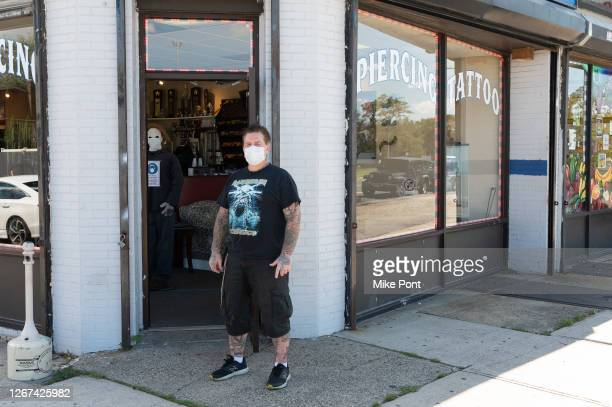 Tattoo artist and owner Bobby Petraglia wearing protective face mask outside Skin Deep Tattoo as the city continues Phase 4 of re-opening following...