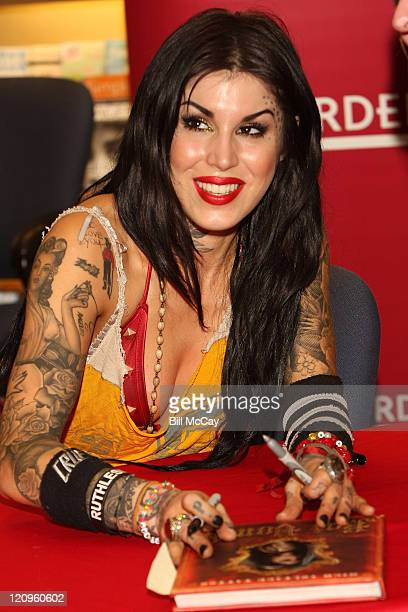 Tattoo Artist and star of the television show LA Ink Kat Von D signs copies of her new book High Voltage Tattoo at Borders Book Store March 7 2009 in...