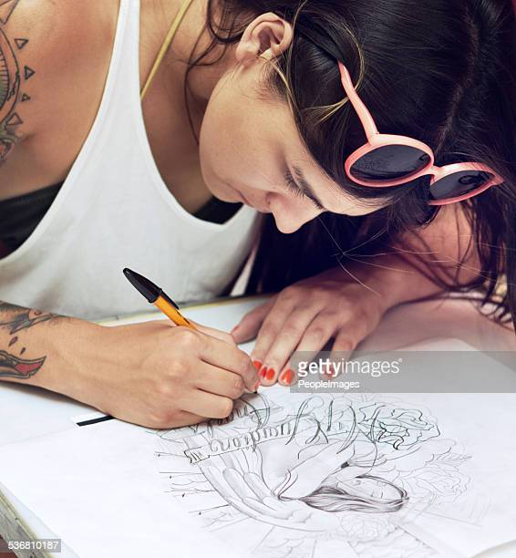 Tattoo artist at work - a masterpiece is born