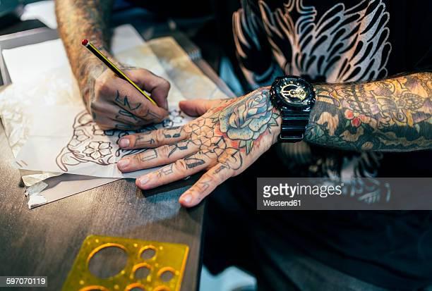 Tattoo artist designing motifs