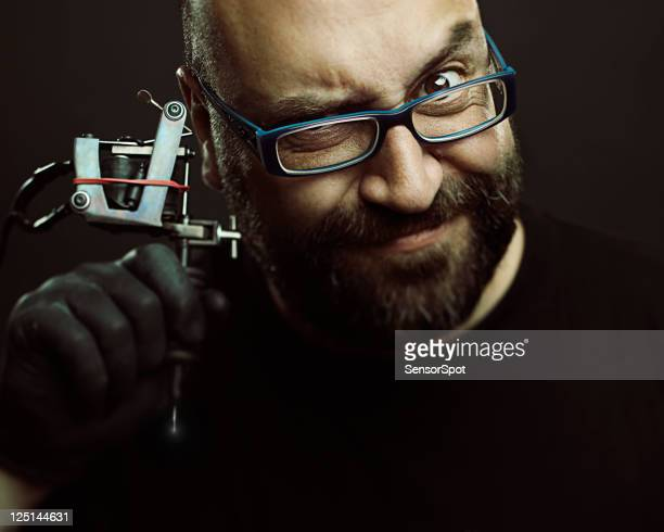 tattoo artist portrait - ugly bald man stock photos and pictures
