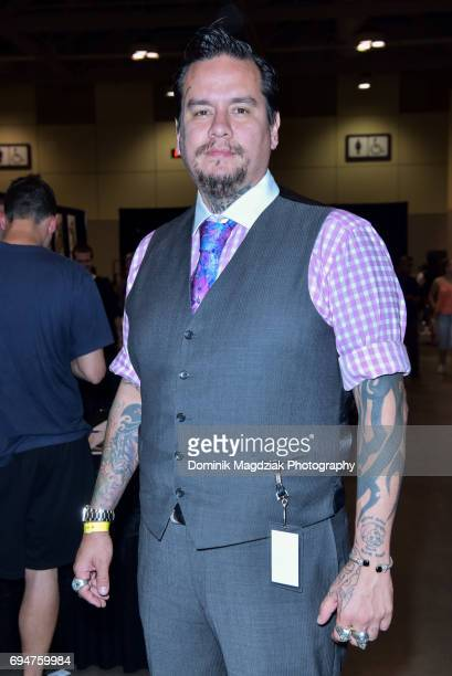 "Tattoo artist Richie Lucero poses for a photo during day two of the ""19th Annual Northern Ink Xposure Tattoo Convention"" at the Metro Toronto..."