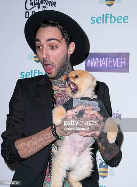Tattoo artist Romeo Lacoste and Jiff the Pomeranian attend Romeo Lacoste's The California Dream grand opening at The California Dream on March 5 2015...