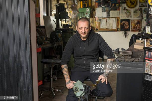 tattoo artist working in his studio - dusan stankovic stock pictures, royalty-free photos & images