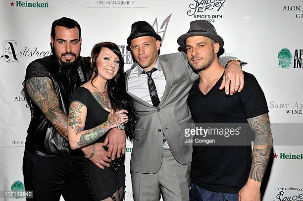 Tattoo artists and TV personalities RobearMegan Massacre Ami James and Billy DeCola attends the grand opening Wooster Street Social Club on June 22...