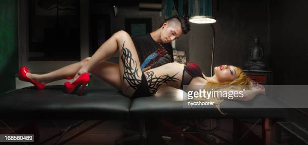 tattoo culture - asian model stock photos and pictures
