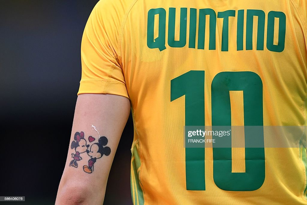 TOPSHOT - A tattoo depicting Mickey Mouse and Minnie is picture on the arm of Brazil's right wing Jessica Quintino during the women's preliminaries Group A handball match Norway vs Brazil for the Rio 2016 Olympics Games at the Future Arena in Rio on August 6, 2016. / AFP / afp / FRANCK