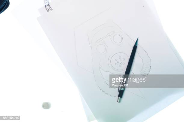 Tattoo design motif on light table in studio
