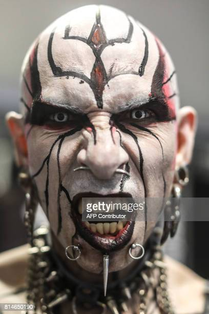 Tattoo enthusiast Jacobo Angel known as Death Angel poses for a photograph during the 8th Expotattoo Colombia Fair in Medellin Antioquia department...