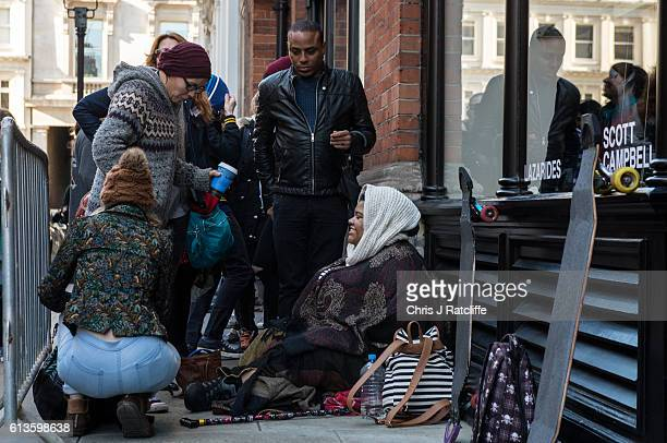 Tattoo enthusiasts queue outside for a chance to have a free tattoo by Scott Campbell at event 'Whole Glory' on October 9 2016 in London England The...