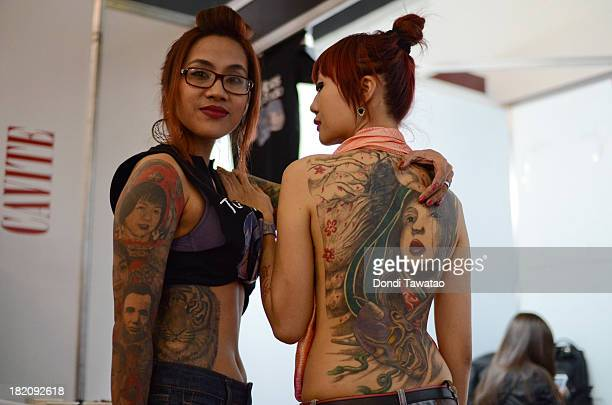 Tattoo enthusiasts take part in the Dutdutan Tattoo Festival on September 28 2013 in Manila Philippines The festival is the biggest tattoo exposition...